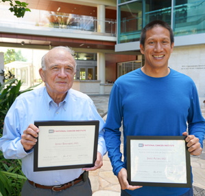 Doctors Jeffrey Berenberg and Jared Acoba holding their certificates of recognition